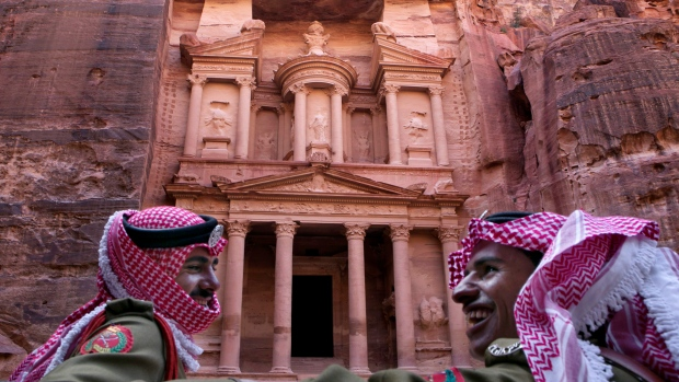 Our Petra tours are always in high demand, simply because this ancient city is truly one of the world's great marvels. Travelers visiting this part of Jordan have the good fortune to experience a wealth of archaeological sites along with ancient aqueducts, temples and tombs. Now, thanks to a recent discovery of great historical significance, future tours may include a massive monument that dates back to 150 B.C. Petra Tours Highlight an Amazingly Rich History Known as the Rose City, Petra is situated in what is today southwestern Jordan. Although it was established in the 300s B.C., it was abandoned in the seventh century A.D. Consequently, this UNESCO World Heritage Site was not rediscovered until 1812. Literally carved into the pink-hued sandstone cliffs that surround it, Petra was a pivotal stop on the caravan route that fed the spice trade and served as the heart of the Nabataean empire. Today, our Petra tours include an in-depth experience of the ongoing archaeological work that continues to unearth previously unseen monuments and historical wonders. Recently, researchers discovered a truly remarkable — but previously unidentified — monument. Newly Discovered Petra Monument May Be 2,150 Years Old In June of 2016, archaeologists Sarah Parcak and Christopher Tuttle discovered a massive platform 800 meters from Petra's central core. Advanced satellite technology provided the detailed imagery that facilitated this discovery. Measuring approximately 184 feet by 161 feet, the platform is lined with columns and features a giant staircase on one side. An interior platform topped by a 28-by-28-foot structure connects to the staircase. Pottery found in and around the monument dates back to 150 B.C., almost as far back as Petra's founding. What This Discovery Means for Future Petra Tours Although Petra provides an ongoing source of significant archeological discoveries, this recent find is particularly exciting. Its age and massive scale are unlike anything else that has been found in the area. Because this discovery is in its earliest stages, it's difficult to determine when the site will be available for visitation. But Petra is a city of constant discovery, and archeological digs are always ongoing. Consequently, most Petra tours involve visits to key discovery sites. When you travel with Discovery Expeditions & Adventure, however, you experience these historical marvels from an insider's perspective. Our Petra tours are led by a working archaeologist with an active excavation site. Rather than being shuffled along behind a rope hoping to catch a glimpse of their work, you will have the opportunity to become immersed in the discovery process, led by a renowned and well-respected scientist. This is only one example of the rich experiences that Discovery Expeditions provides to those who travel with us. Contact us today to learn more about our expeditions and adventure tours. We tour Africa, Egypt, Antarctica, Australia and many more amazing destinations. In fact, our next trek to Petra, Jordan, takes place in October. Only a few spots remain, so contact us today to join us on of our upcoming Petra tours.